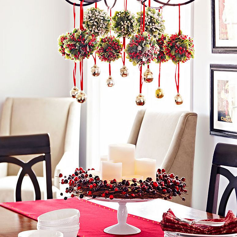 Mistle toe balls and bells hanging from the chandelier make for a fun festive decorative piece