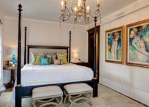 Modern-Victorian-bedroom-with-lovely-wall-art-and-a-beautiful-four-poster-bed-217x155