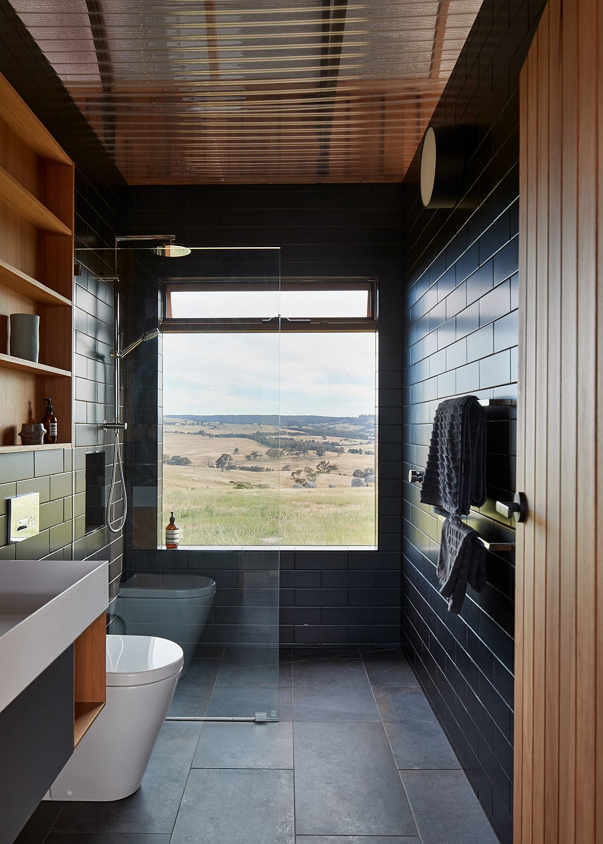 Modern rustic bathroom with a touch of sophistiation and a woodsy ceiling