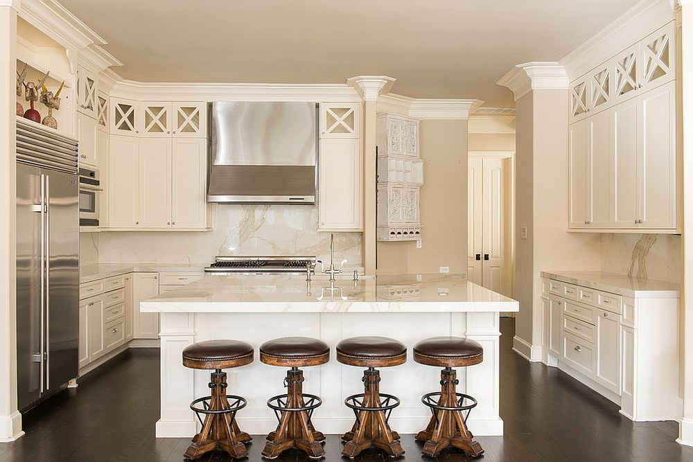 Monochromatic white and cream kitchen with bar stools that stand out visually