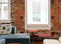 Multi-colored-rug-for-the-brick-wall-eclectic-style-living-room-with-comfy-decor-217x155