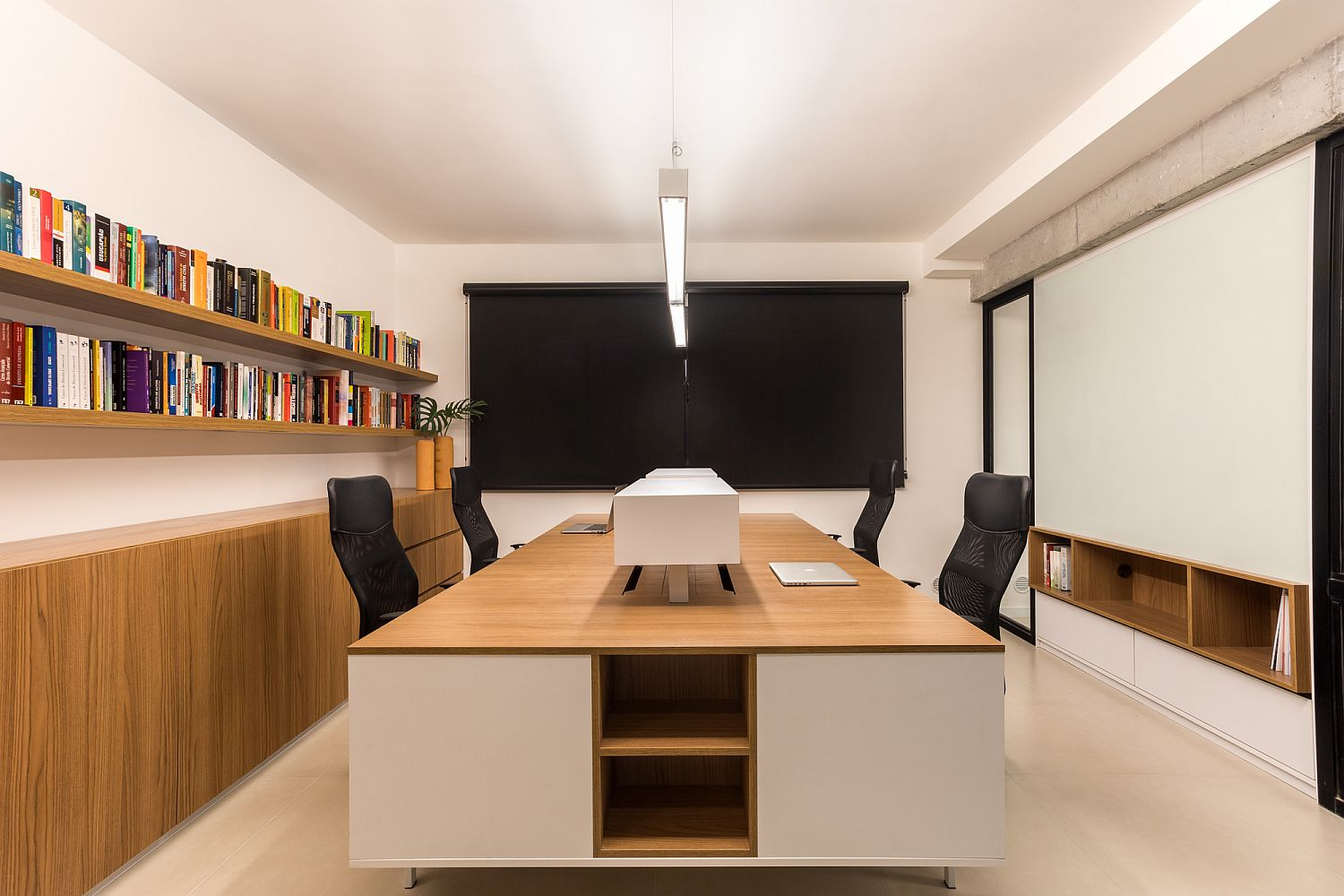 Neutral hues shape the meeting room with wood and white taking over