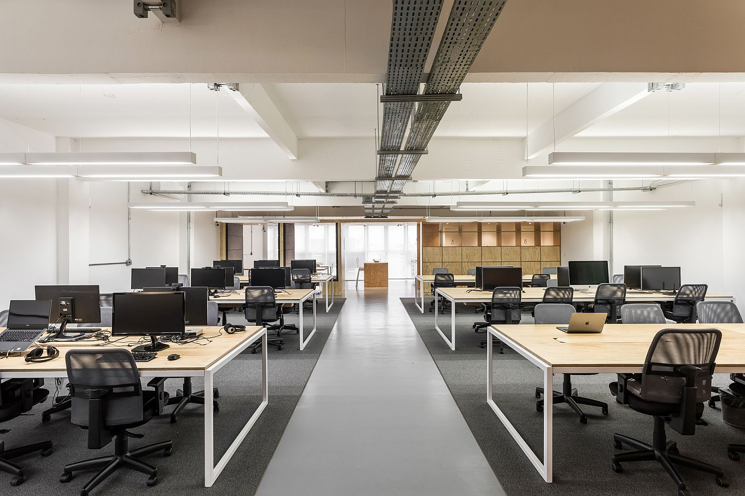 Open, spacious and well-lit working areas of the modern industrial office in brazil