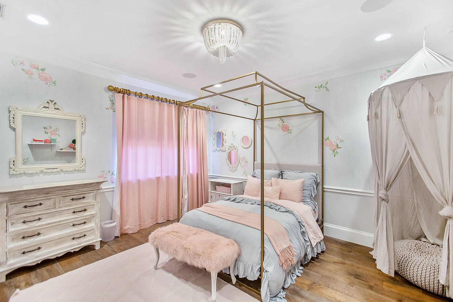 Pastel pinks and blues along with lovely prints add color to the delightful shabby chic bedroom