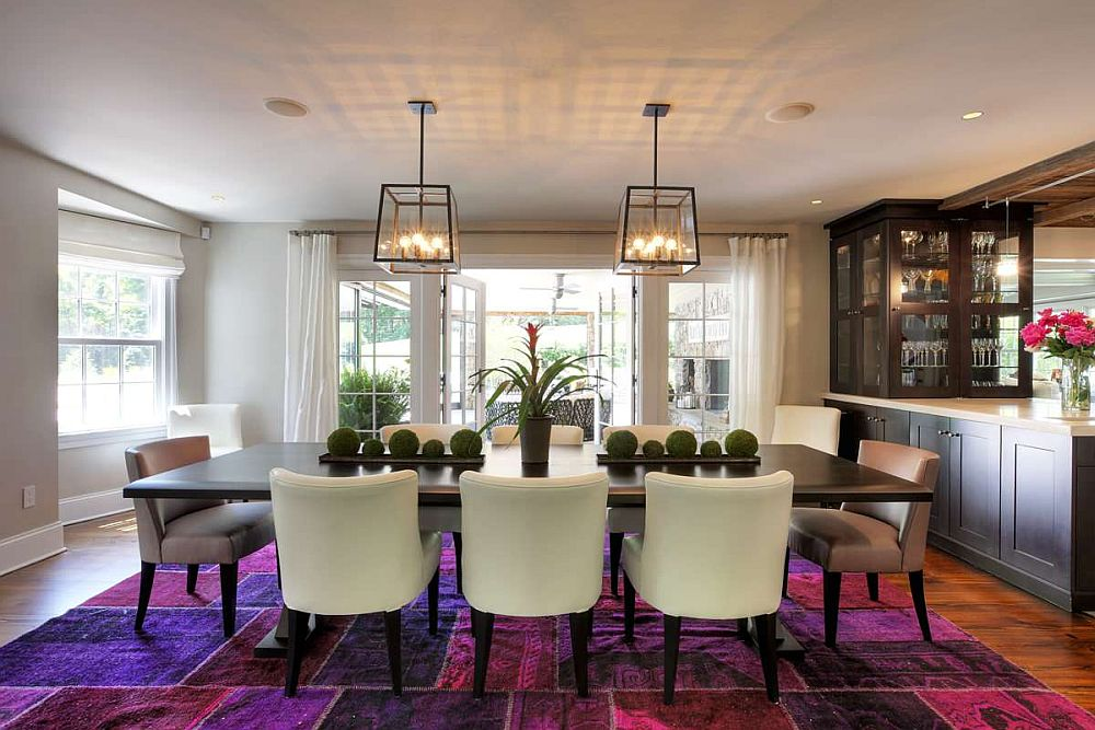 Patchwork pattern rug in pink and purple is the real showstopper in this dining room