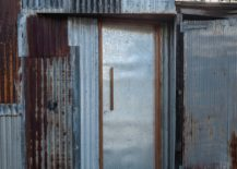 Pieces-from-the-original-disassembled-tin-shed-cover-the-new-facade-217x155