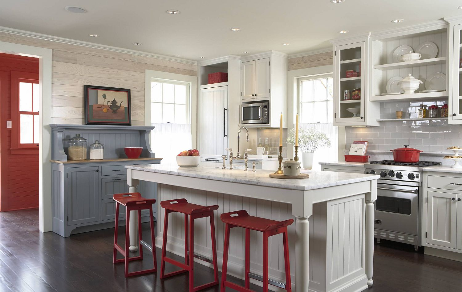 Pops of red enliven the traditional cottage style kitchen in white and gray