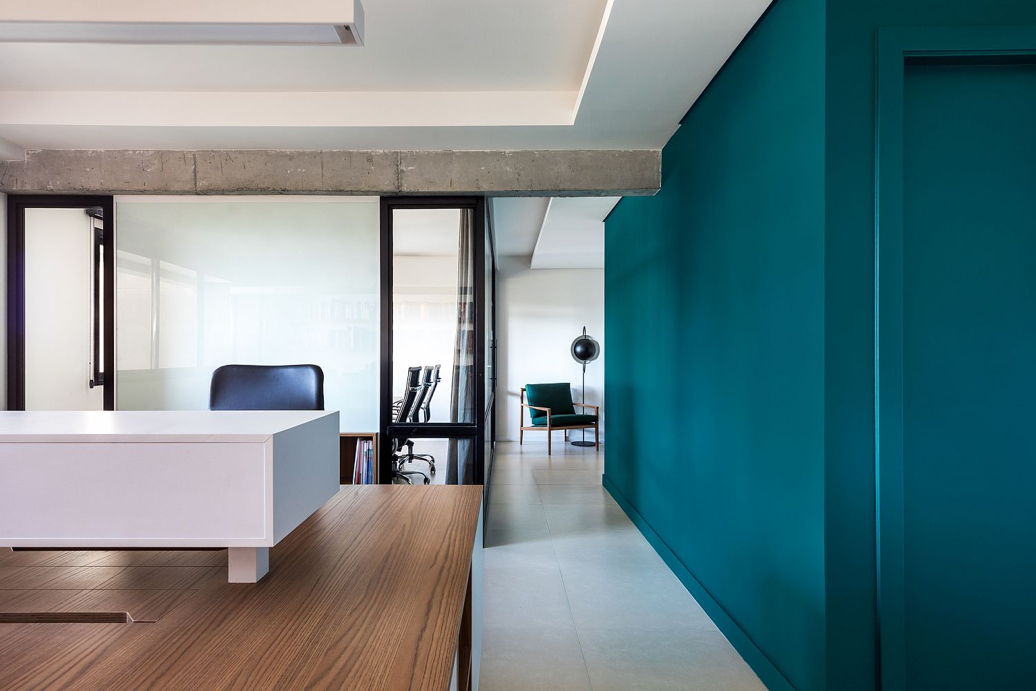 Porcelain flooring, wood and white walls and engaging green accents inside the office