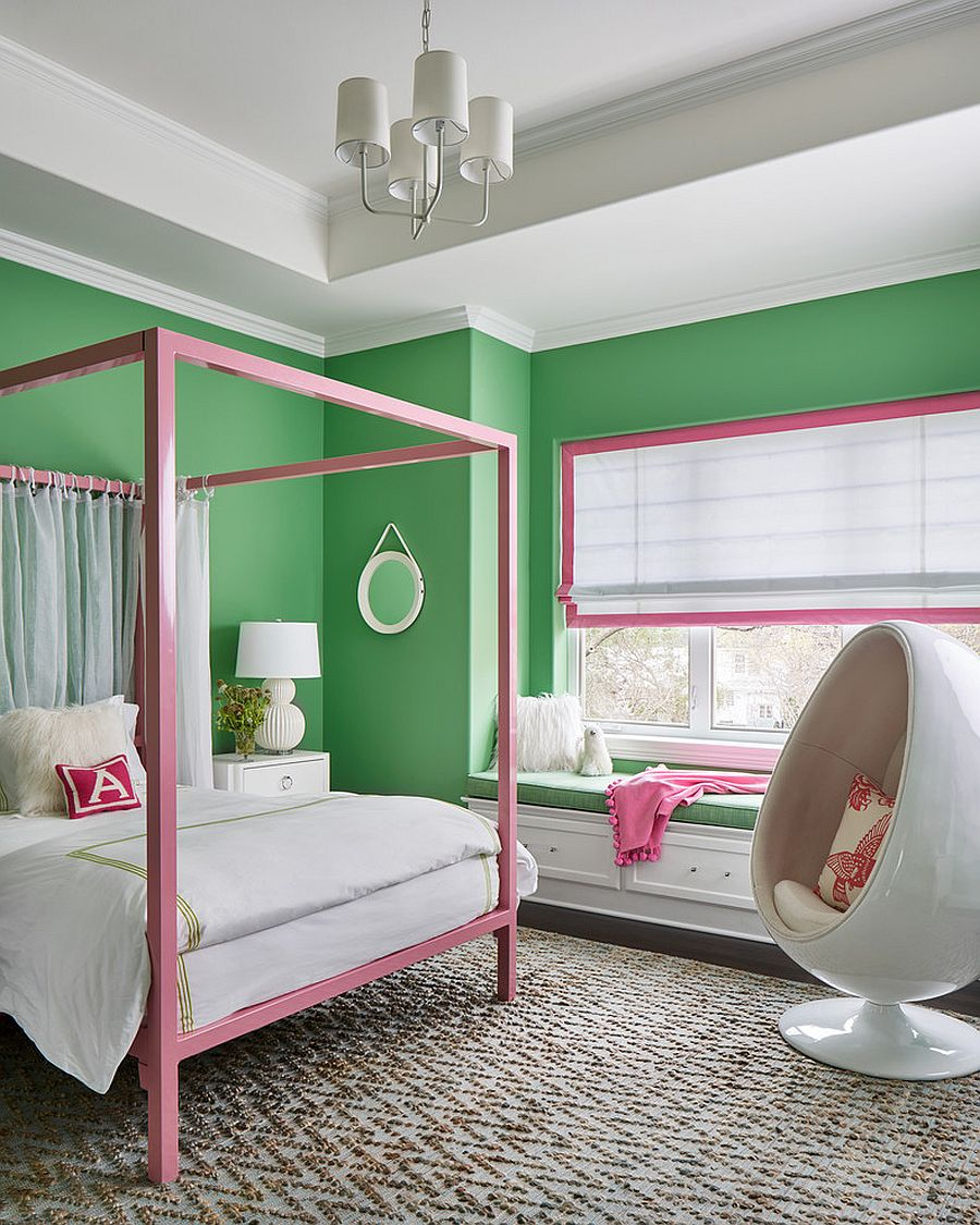 Pretty kids' bedroom in green with pops of pink that give the space a festive look