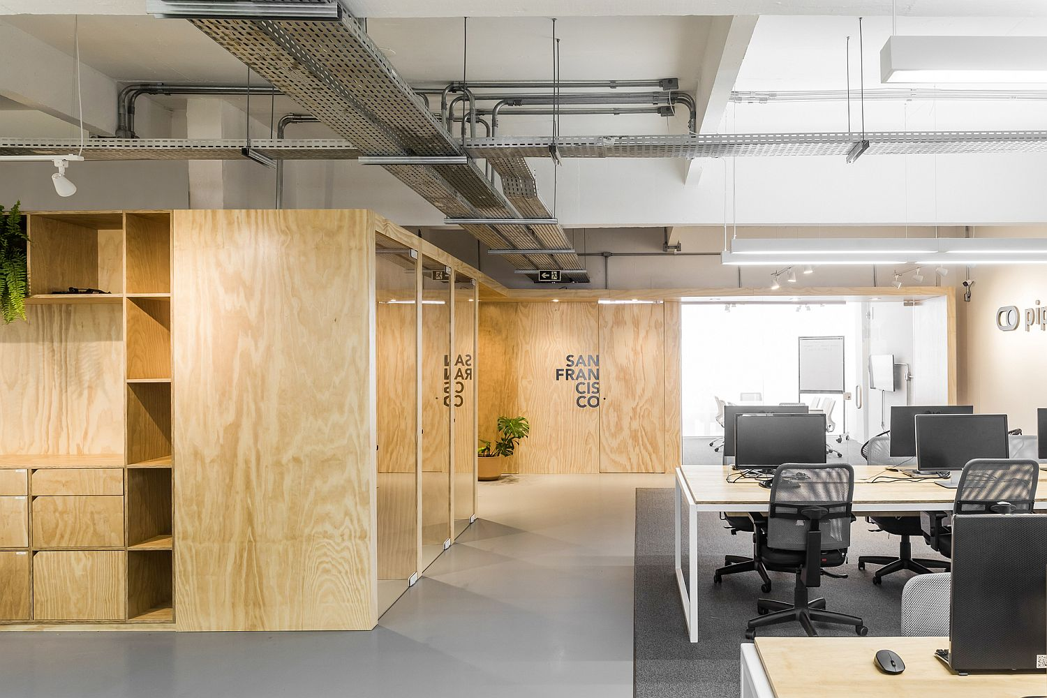 Raw concrete wood, and industrial elements give this office a modern rustic look