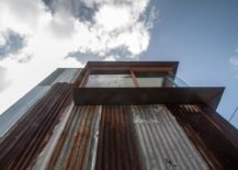 Salvaged-and-rusted-metal-covers-the-facade-of-the-house-217x155