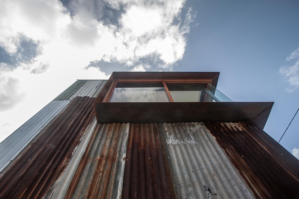Salvaged-and-rusted-metal-covers-the-facade-of-the-house