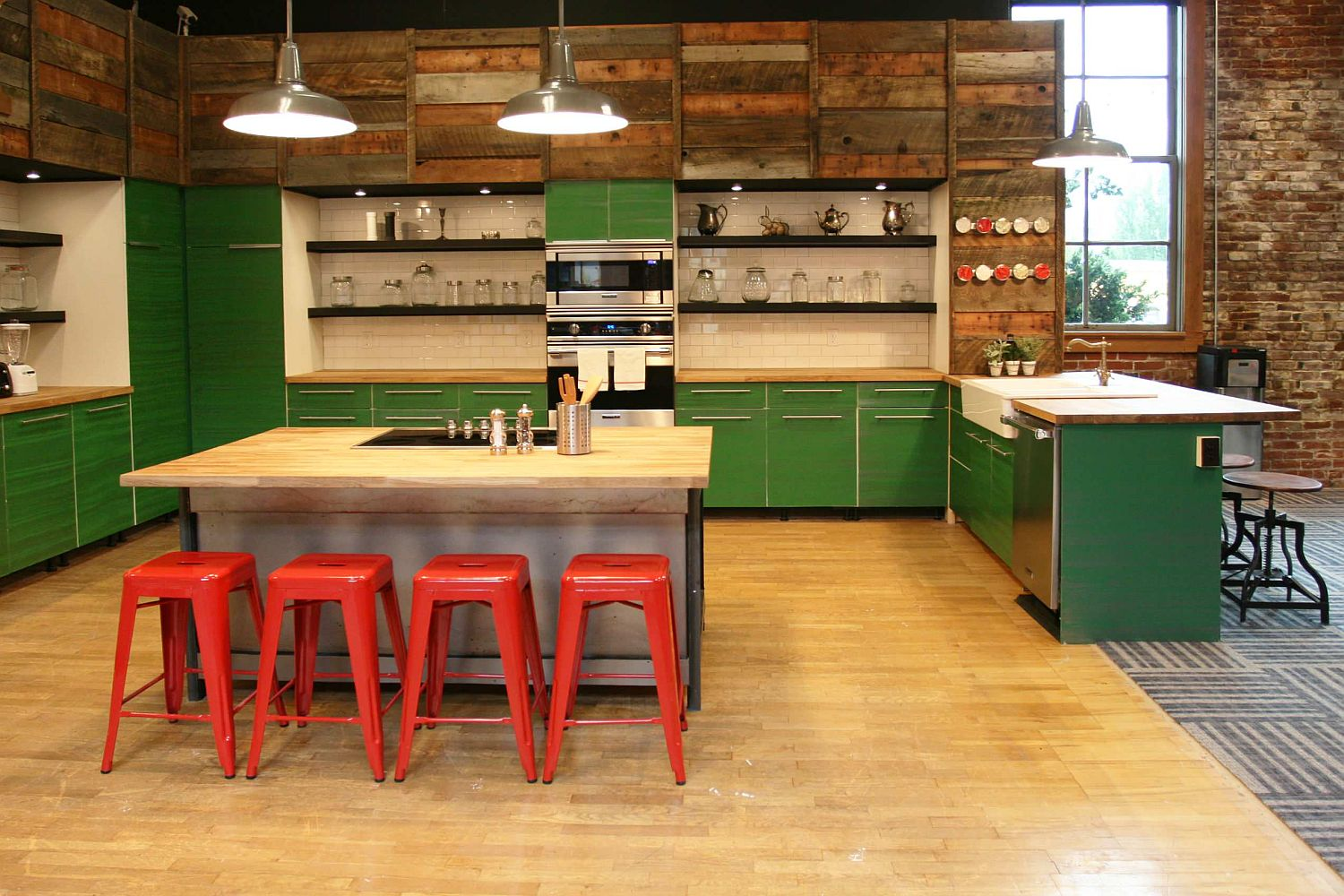 Simple backless industrial bar stools in red are perfect for kitchen with matching industrial charm