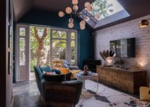 Small-eclectic-living-room-with-brick-wall-backdrop-skylights-and-a-view-into-the-world-outside-217x155