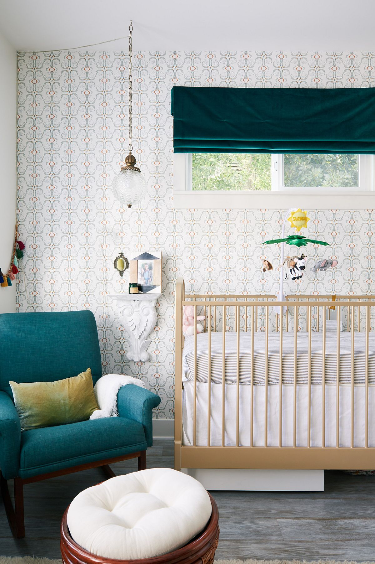 Small eclectic nursery with a pop of dark green and a neutral backdrop