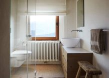 Small-wood-and-white-bathroom-with-ample-natural-ventilation-217x155