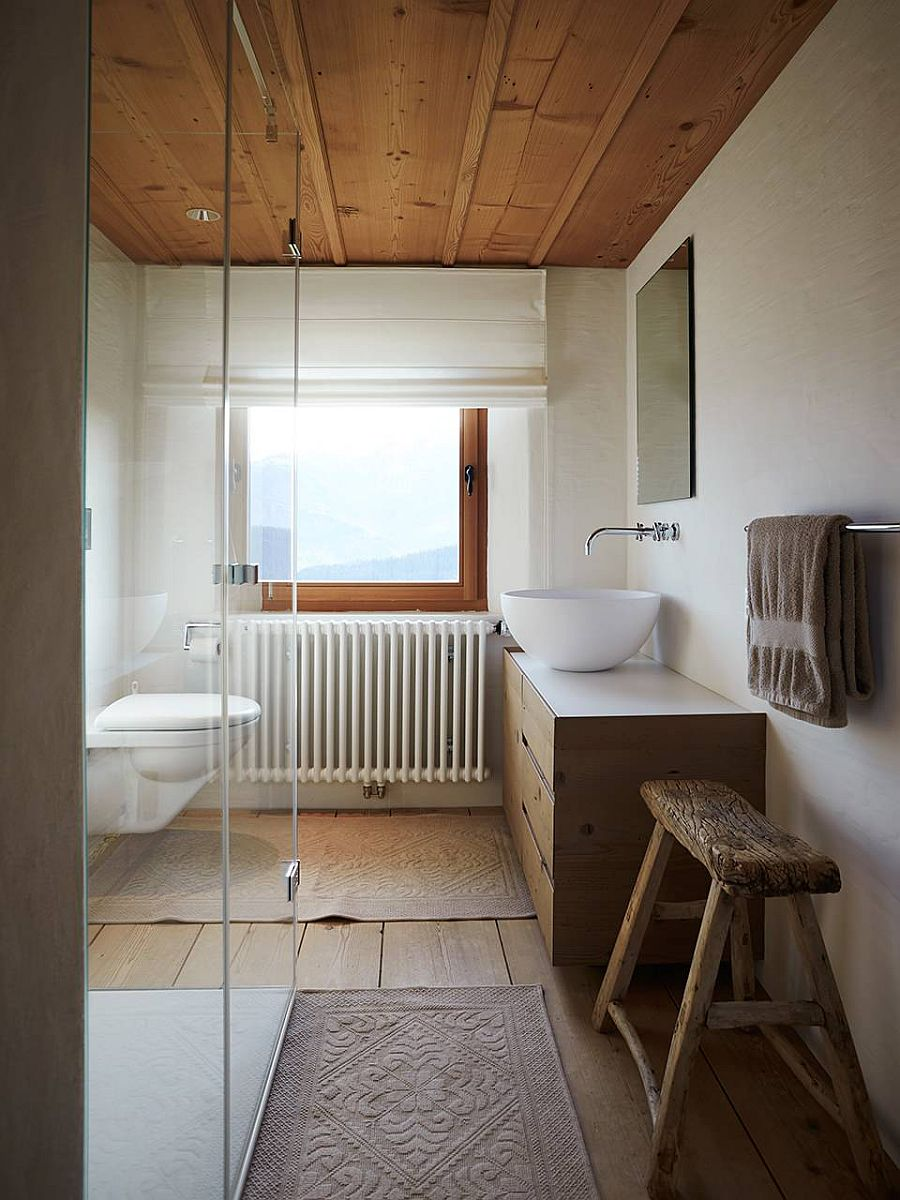 Small wood and white bathroom with ample natural ventilation