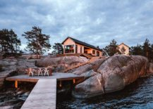 Steps-leading-to-the-deck-along-with-a-great-outdoor-dining-area-on-the-edge-of-water-217x155