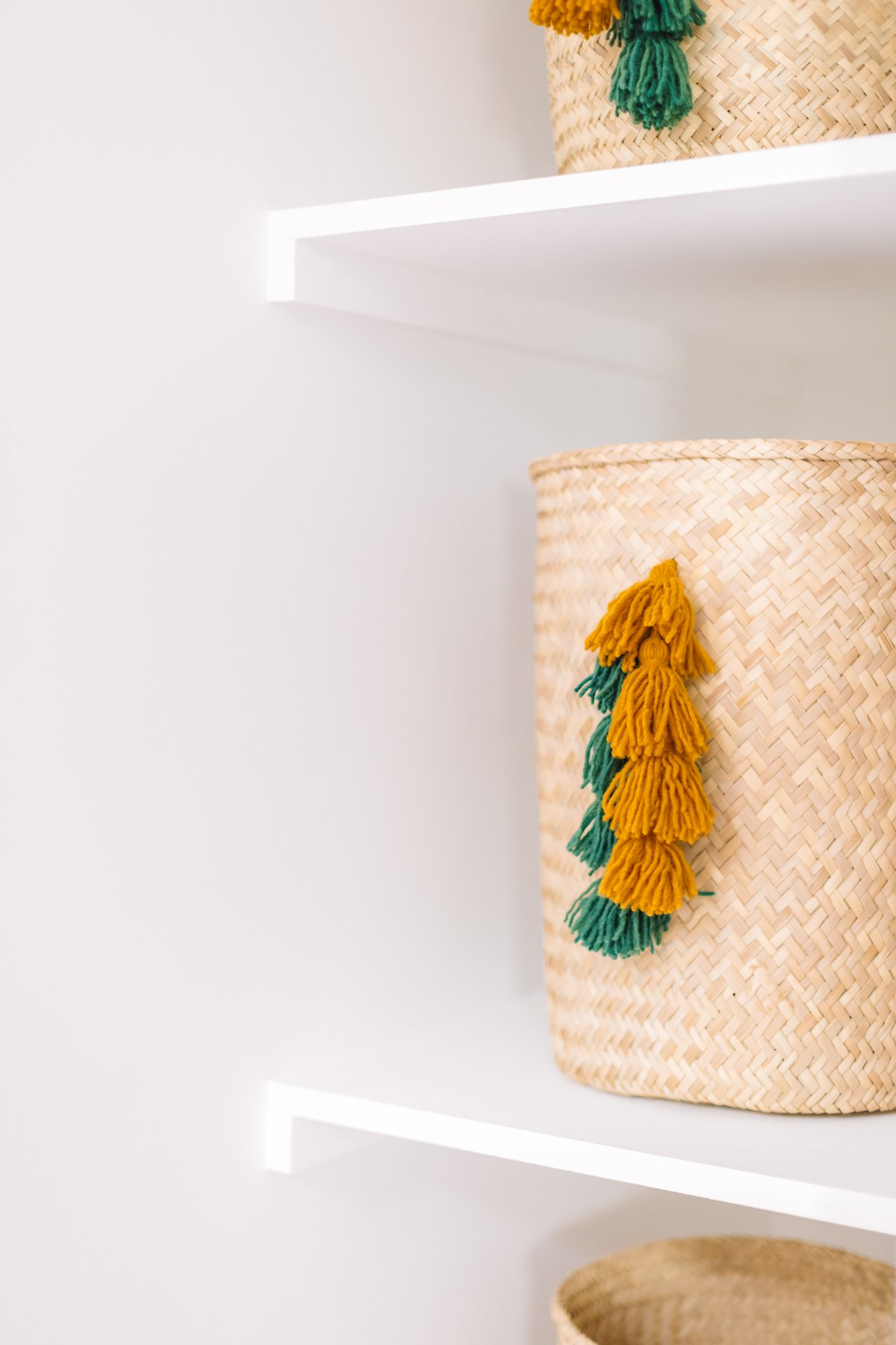 Storage baskets with green and yellow tassels