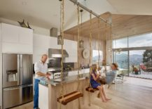 Swing-seats-suspended-from-the-ceiling-along-with-skylight-and-lovely-views-give-this-kitchen-a-refreshingly-fun-appeal-217x155