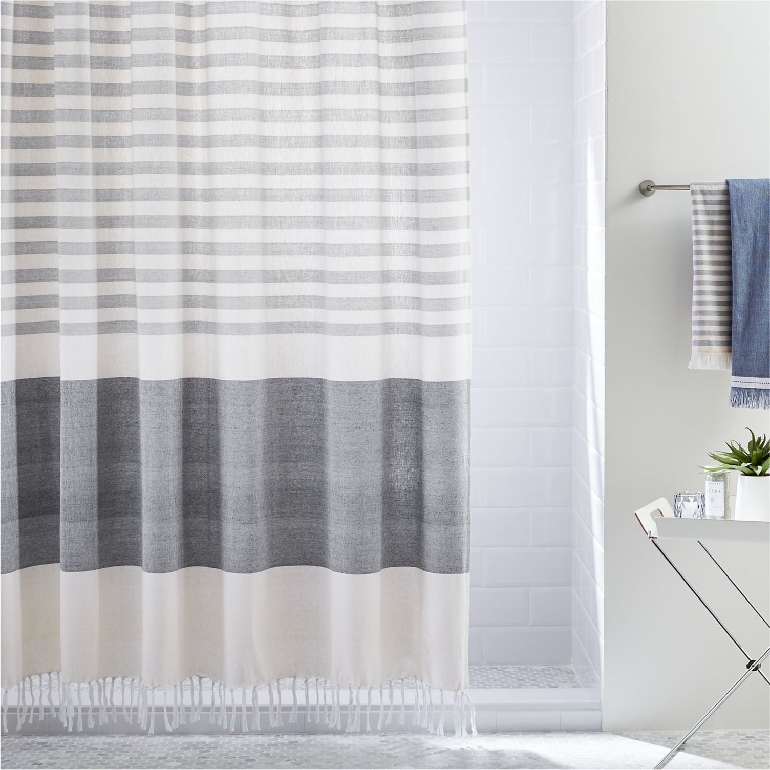 Tasseled shower curtain with grey stripes