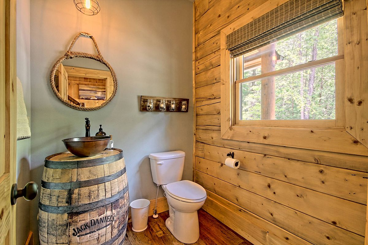 Tiny rustic bathroom with log cabin style and plenty of woodsy charm