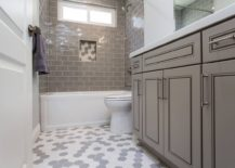 Transitional-style-bathroom-vanity-in-gray-along-with-white-and-gray-hexagonal-floor-tiles-217x155