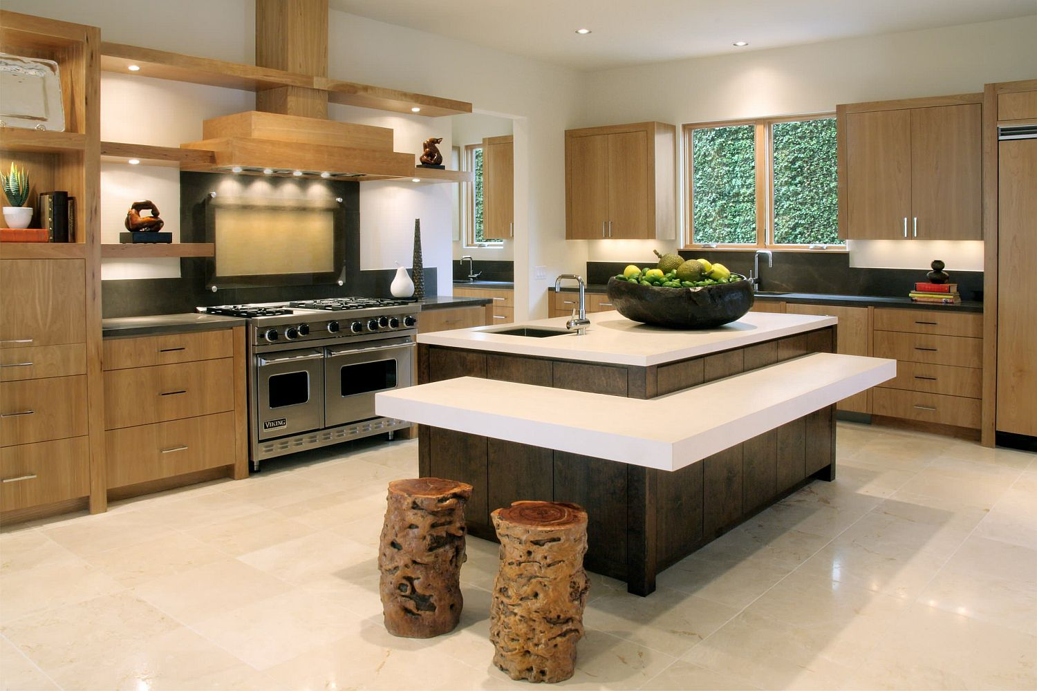 Tree stumps turned into dashing bar stools in the contemporary kitchen