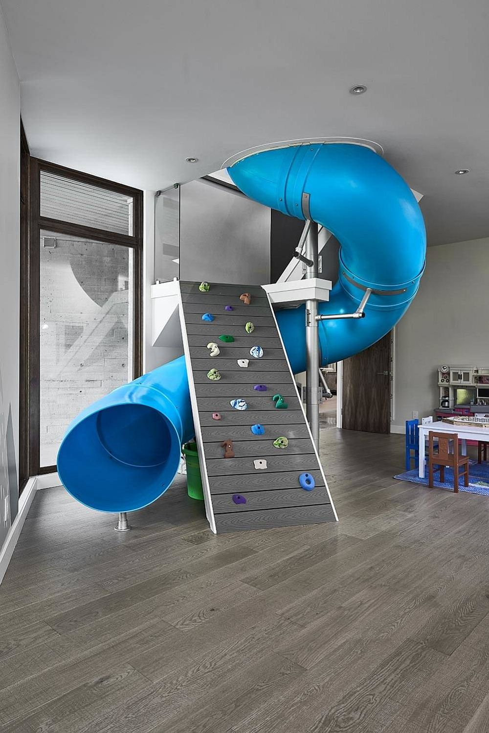 Tube slide and climbing wall rolled into one in the kids' room