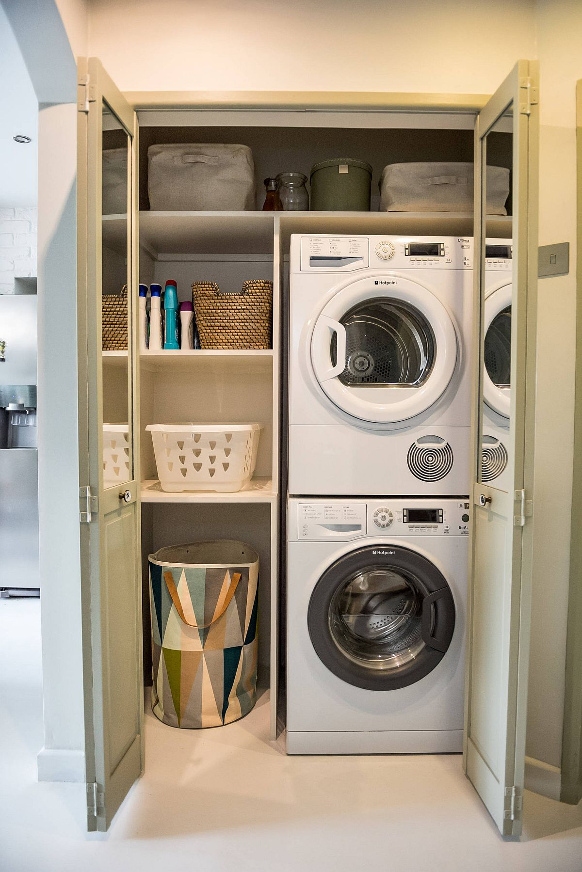 kitchen cabinet repurposed for stacked washer and dryer