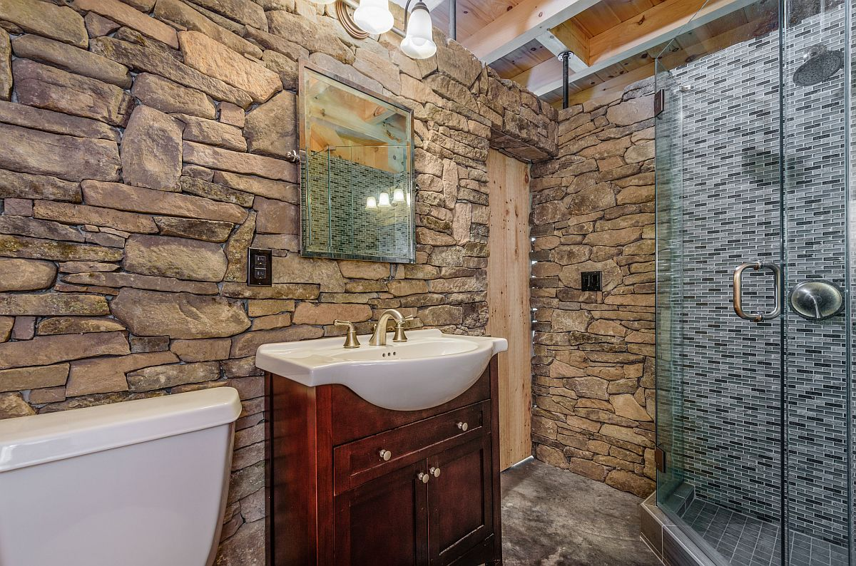 Using stone in the rustic bathroom to accentuate its look