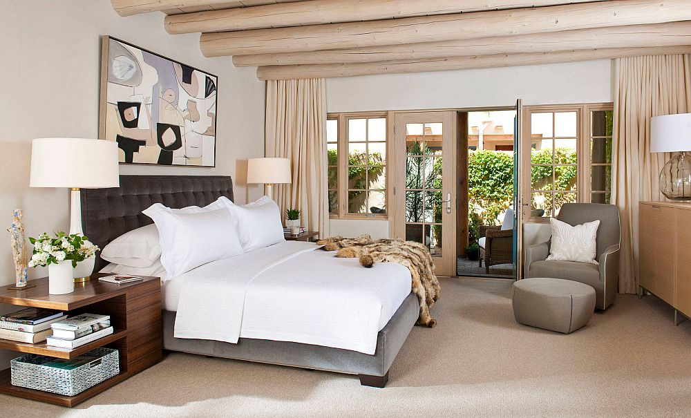 Using the wooden ceiling beams in the polished bedroom with style