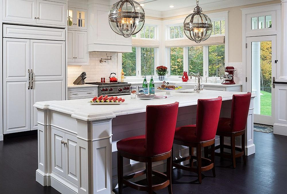 Victorian kitchen with comfortable and regal red bar chairs that steal the spotlight
