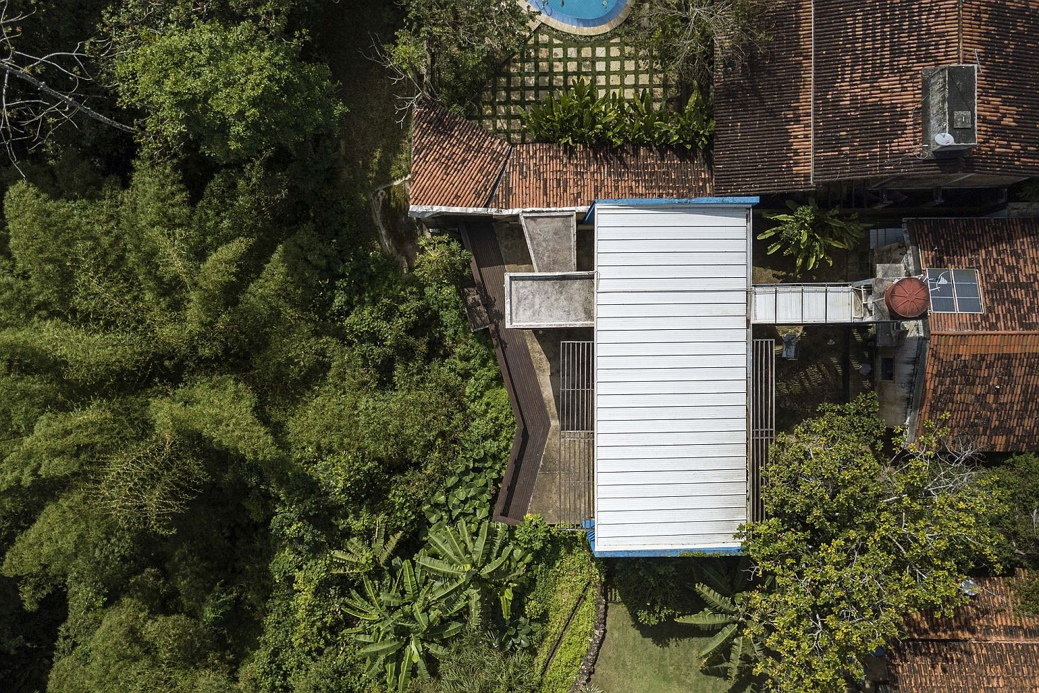 View from the sky of the extended modern house in Brazils surrounded by jungles