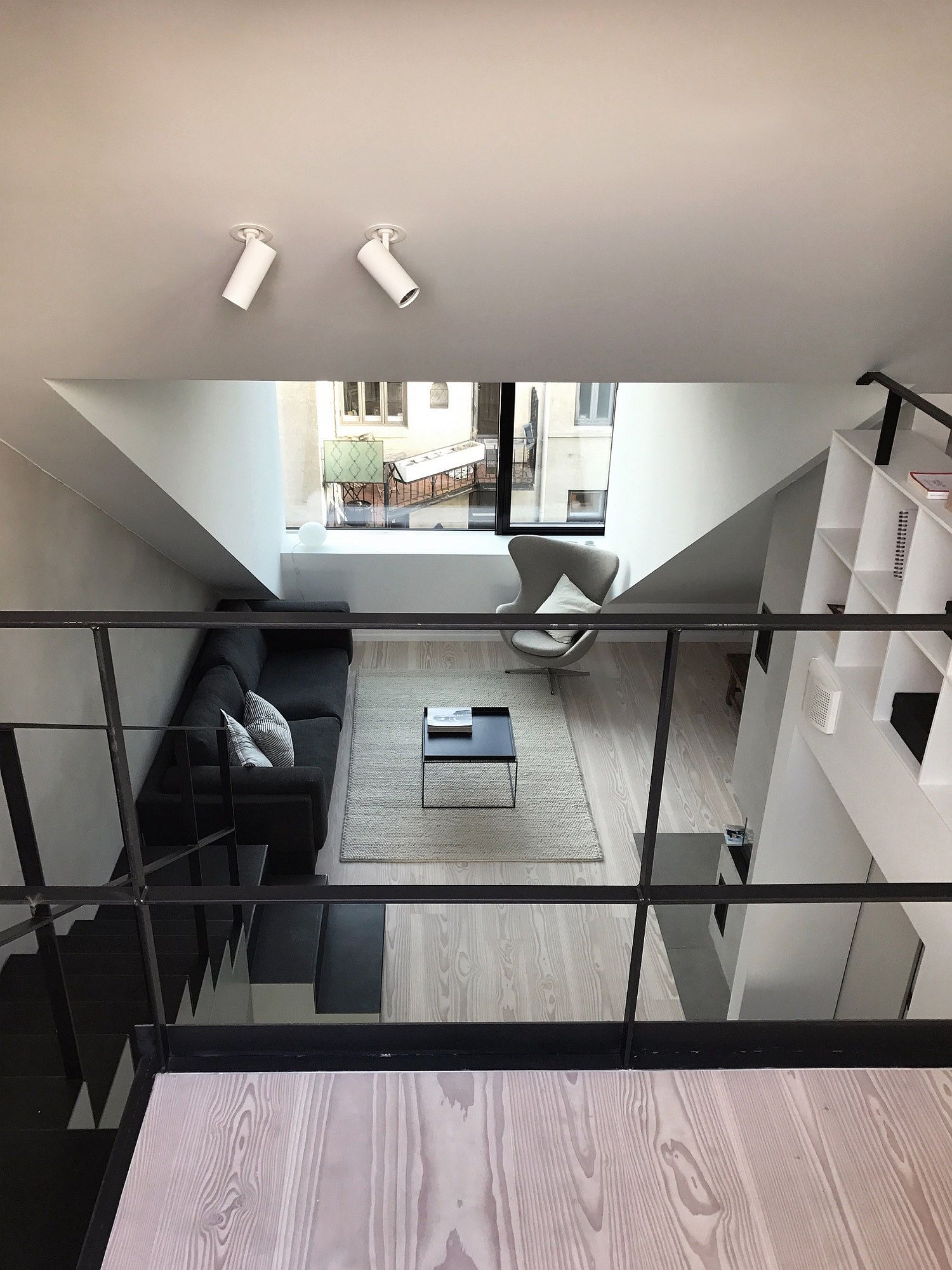 View of the living area from the upper level of the apartments