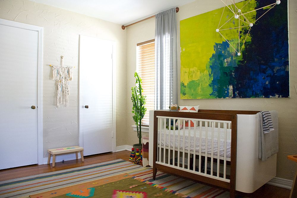 Wall art piece in the nursery complements the color scheme of the rug