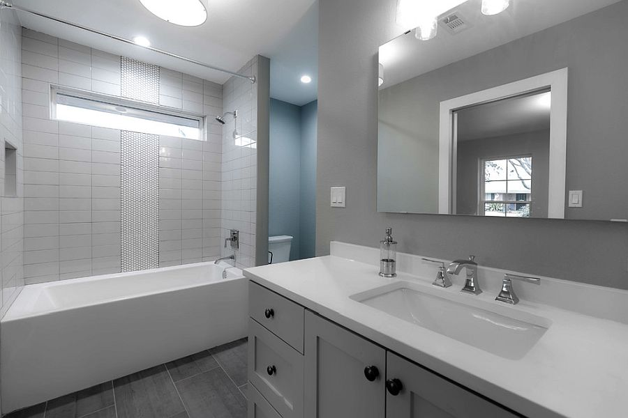 White and gray bathroom idea where the latter dominates the backdrop
