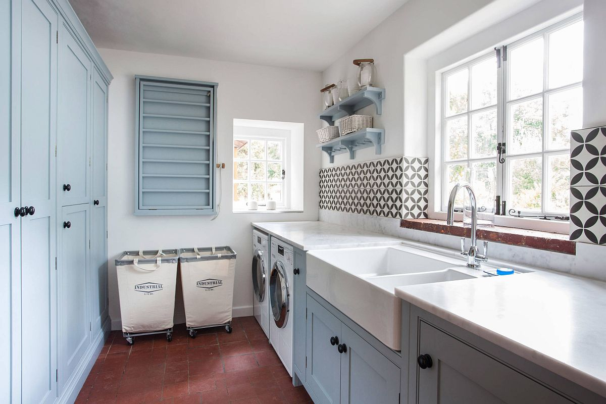 large laundry room with farmhouse sink and black and white tiled backsplash