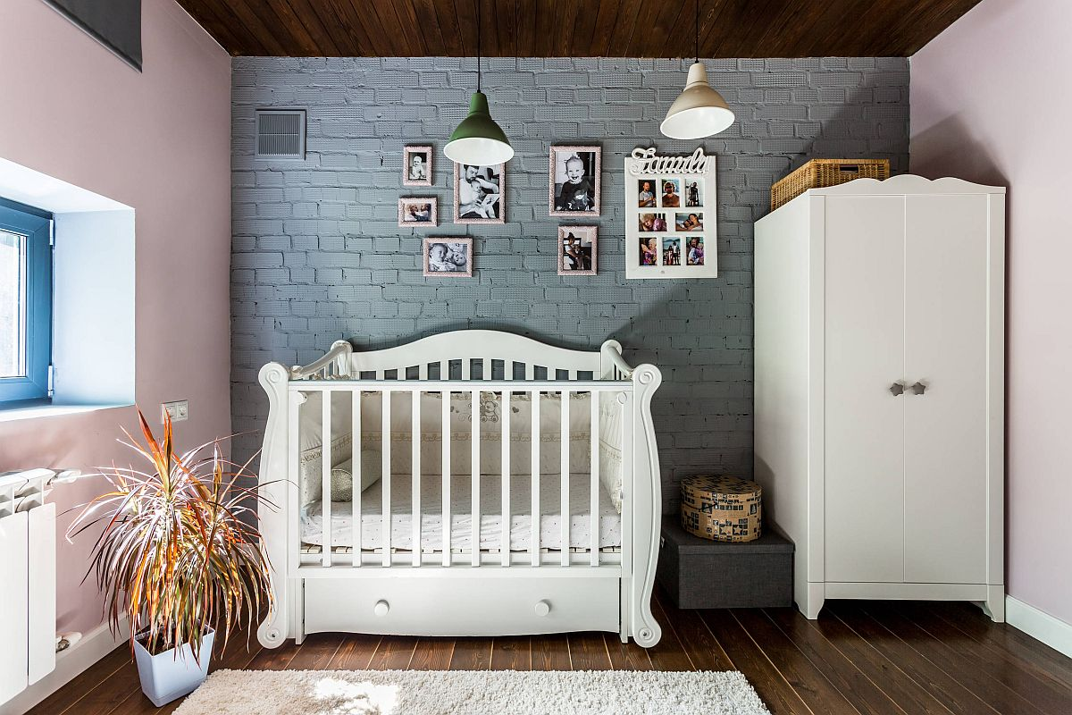 Whitewashed brick wall and wood ceiling in the eclectic nursery with unique decor
