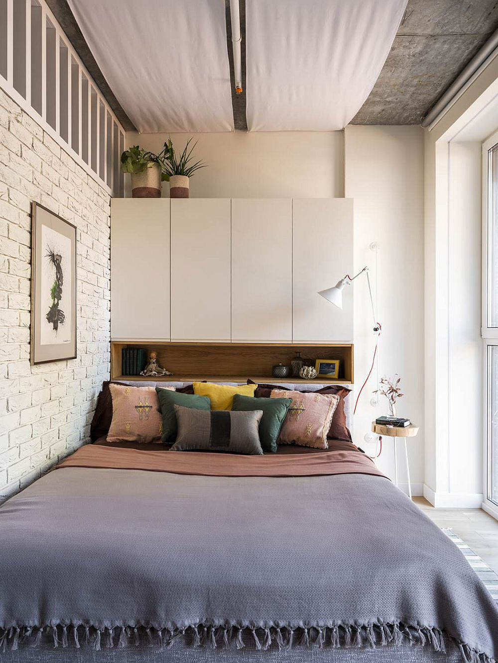 Whitewashed brick wall for the tiny modern Scandinavian style bedroom