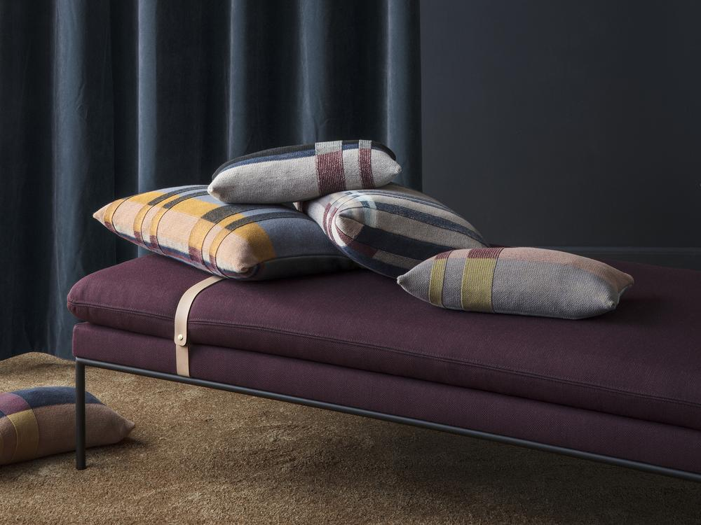 Wine-colored fabric on a Scandinavian daybed