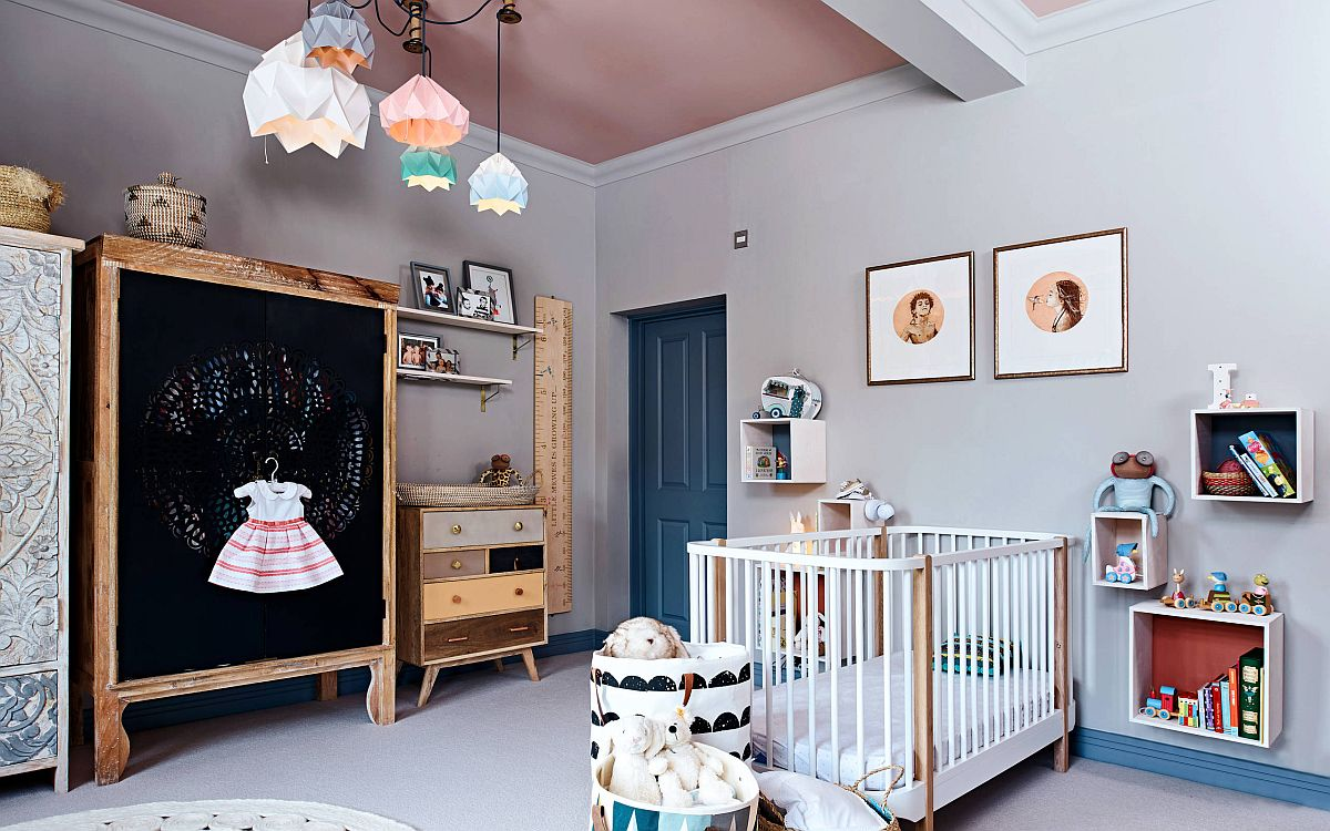 Wood, chalkboard paint and a crisp, neutral backdrop shape this eclectic nursery