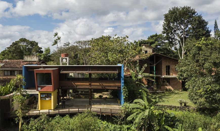 Wood and Concrete Pavilion Extends Modern Brazilian Home into Greenery