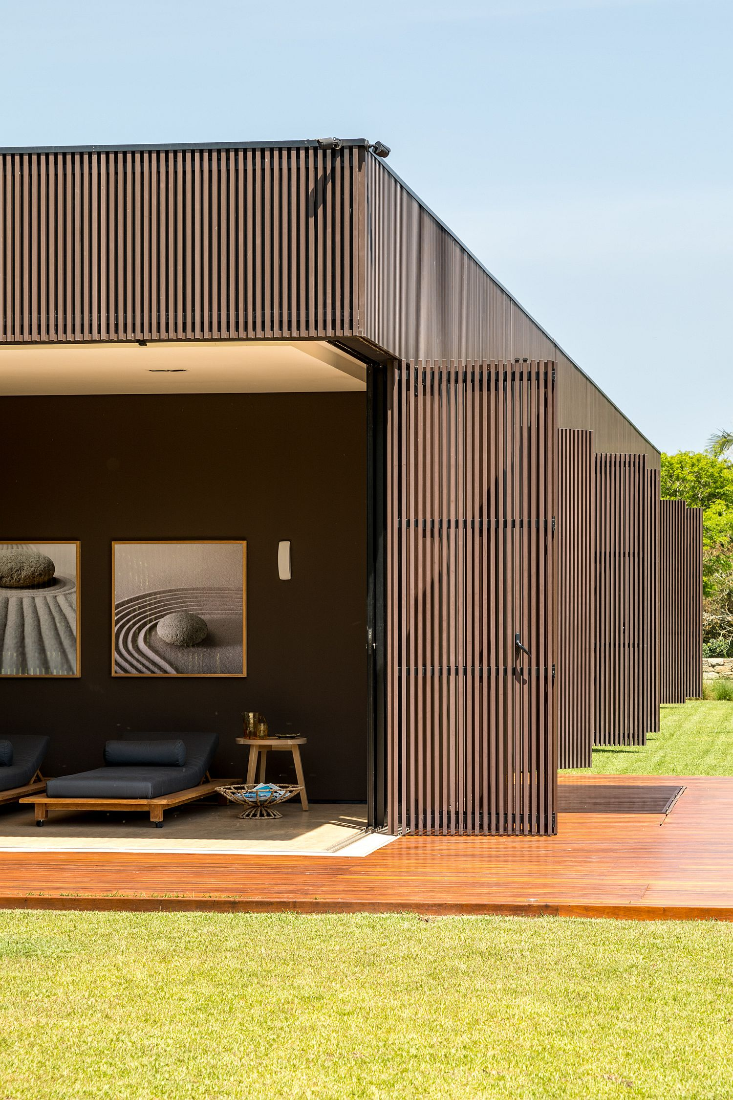 Wooden-shutters-open-up-to-connect-the-interior-with-the-landscape-outside
