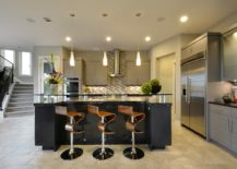 Woodsy-bar-stools-also-add-geometric-style-and-curvy-elegance-to-the-kitchen-217x155
