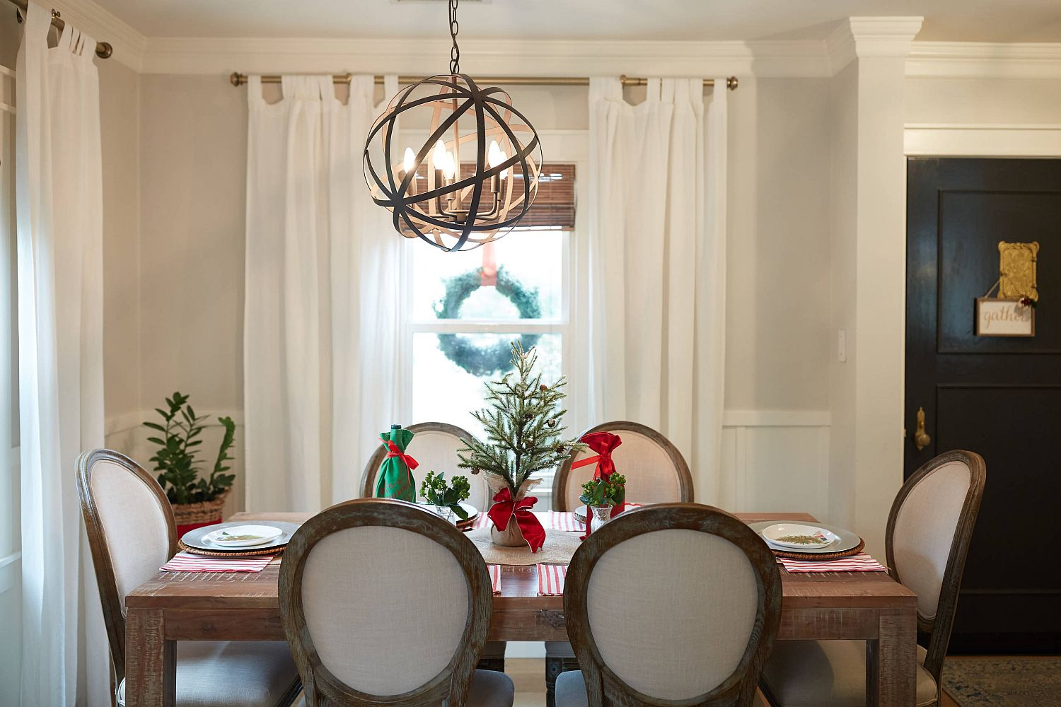 Wreath outside the window and dining table decorations bring Holiday cheer to this dining room in San Francisco