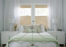 Wrought-iron-bed-frame-painted-pastel-green-brings-color-to-the-chic-bedroom-in-dreamy-white-217x155