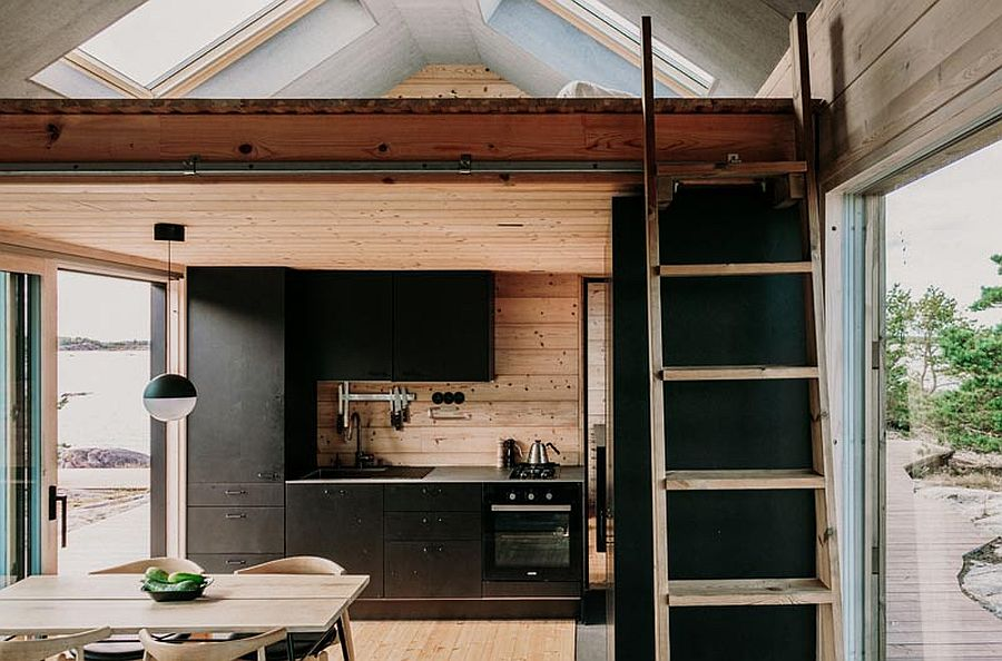 dashing-black-shelves-with-modern-ergonomics-create-efficient-kitchen-inside-the-cabin