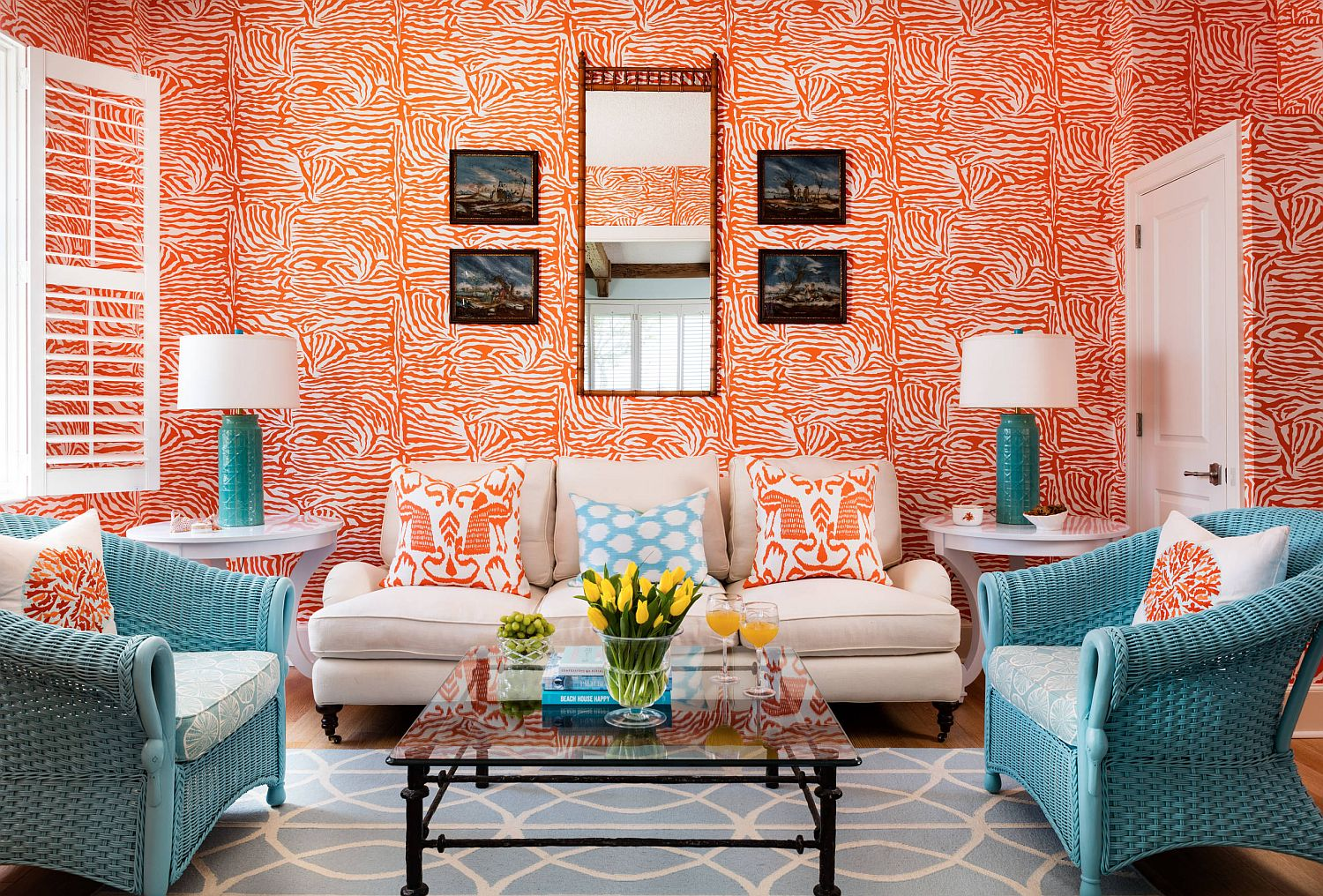Awesome use of orange in the modest tropical living room