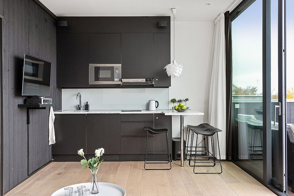 Balanced-blend-of-black-and-white-in-the-light-filled-contemporary-kitchen